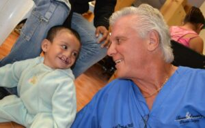 Dr. Yarish with Happy Baby Boy with Cleft Lip Before His Reconstructive Surgery