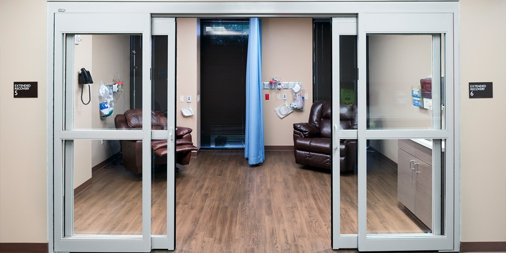 Opened Glass Sliding Doors of Examination Room